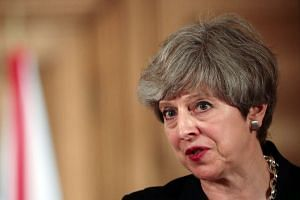 May's (above) botched gamble on a snap election lost her party its majority in the 650-seat British parliament.