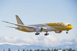 File photo show Scoot's 787 Dreamliner making a landing.