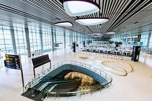 The departure hall (above) and departure transit area (below, right) were some of the areas revealed on Changi Airport's Facebook page on Monday.