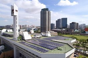 Aerial view of the solar panels on JTC's Jurong Town Hall rooftop, overlooking Jurong Gateway.