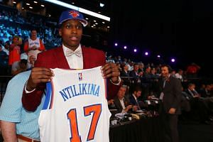 Frank Ntilikina of France holds up a team jersey after being introduced as the number eight overall pick to the New York Knicks in the first round of the 2017 NBA Draft at Barclays Center.