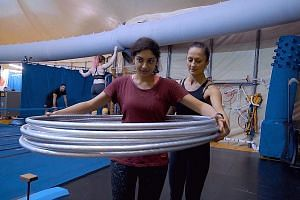 Reporter Gurveen Kaur trying hoop manipulation with Irina Akimova.
