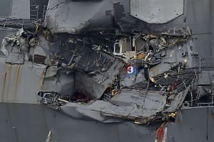 Damage to the guided missile destroyer USS Fitzgerald is seen as the vessel is berthed at its mother port in Yokosuka, southwest of Tokyo, on June 18, 2017.