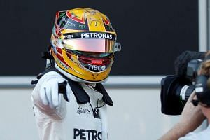 Hamilton reacts after the qualifying session.