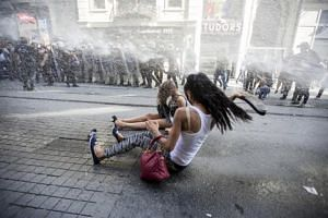 Riot police use a water cannon to disperse LGBT rights activist before a Gay Pride Parade in central Istanbul, Turkey on June 28, 2015.