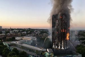 Flames and smoke coming from the Grenfell tower after a fire broke out.