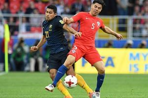Australia's midfielder Massimo Luongo (left) vies with Chile's midfielder Francisco Silva on June 25, 2017