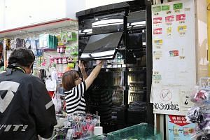 Good Price Centre, a convenience store in Ang Mo Kio Avenue 1, has been using black opaque glass cabinets for its cigarettes since last week. The point-of-sale display ban for tobacco products begins in August.