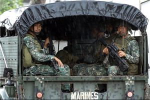 Philippine soldiers ride on a military vehicle while government forces continue their assault against insurgents from the Maute group, in Marawi, Philippines June 26, 2017.