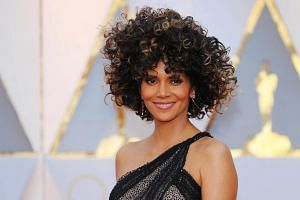 Actress Halle Berry arrives during the 89th Academy Awards Oscars Red Carpet Arrivals in Hollywood, California on Feb 26, 2017.