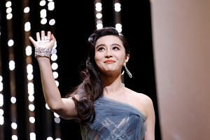 Fan Bingbing arrives on stage during the 70th Cannes Film Festival closing ceremony.