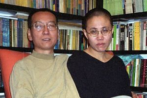 This file handout photo released by the Liu family and taken on October 22, 2002 shows Chinese dissident and Nobel Peace laureate Liu Xiaobo and his wife Liu Xia in Beijing.