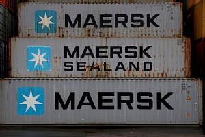 Empty Maersk shipping containers are seen stacked at Peel Ports container terminal in Liverpool, Britain, Dec 9, 2016.