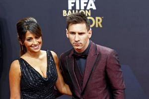 Barcelona's Lionel Messi, a nominee for the 2014 FIFA World Player of the Year, arriving with partner Antonella Roccuzzo for the FIFA Ballon d'Or 2014 soccer awards ceremony at the Kongresshaus in Zurich on Jan 12, 2015.