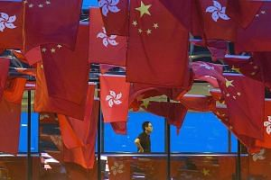 A bridge in Hong Kong decorated with China's and Hong Kong's flags ahead of the special administrative region's handover anniversary. Hong Kong is marking the 20th anniversary of the former British colony's return to Chinese rule tomorrow. It is the