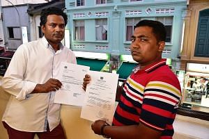 Mr Alam Ataur Rahman (left) and Mr Islam Mohd Rubayet with their respective Labour Court awards. Pro-bono lawyers arranged by non-governmental organisation Transient Workers Count Too are trying to recover the debts for the two men. Their former empl