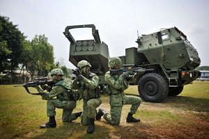 Soldiers from the 23rd Battalion Singapore Artillery (23 SA) demonstrating the deployment of the High Mobility Artillery Rocket System at Khatib Camp on Sept 5, 2011.