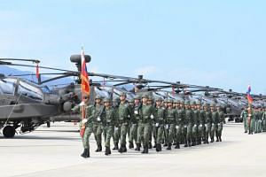 A handout photo made available by the Military News Agency shows the ceremony marking the formaton of the second contigent of Apache AH-64E attack helicopters at a military base in Taoyuan County, northern Taiwan, 28 June 2017. Taiwan purchased 30 Ap
