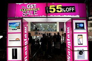 A pre-GST clearance sale at a showroom in Bhopal last Friday. Dealers all over India offered huge discounts before the Goods and Services Tax (GST) was implemented. The unified tax is expected to boost manufacturing, facilitate the movement of goods