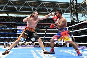 Jeff Horn (left) landing a punch on Manny Pacquiao during their WBO World Welterweight title match in Brisbane on July 2, 2017.