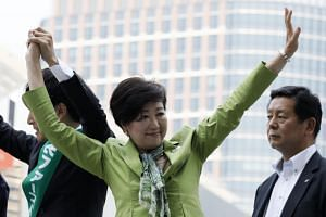 Tokyo Governor Yuriko Koike waving to voters during a campaign speech in Tokyo on June 23, 2017.