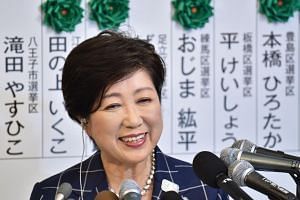 Tokyo Governor Yuriko Koike, who currently is the leader of the newly-formed Tomin First no Kai (Tokyo Residents First) party, smiles during a television interview in Tokyo, on July 2, 2017.