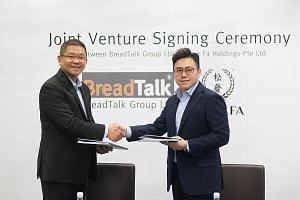 BreadTalk chief executive Henry Chu (left) and Mr Yeo Hart Pong, managing director of Song Fa Holdings, at the signing of the joint venture agreement.