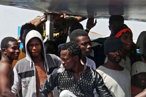 Some of 402 migrants rescued in the Mediterranean Sea disembark in Brindisi, Italy, June 30, 2017.