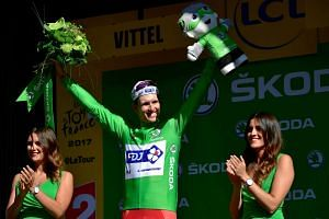 Demare celebrates his green jersey of best sprinter at the end of the 207,5 km fourth stage.