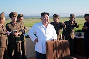 File photo of North Korean leader Kim Jong Un (centre) inspecting the test of a new anti-aircraft guided weapon system.