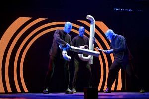 The Blue Man Group performing with PVC pipes.