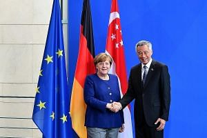 Prime Minister Lee Hsien Loong with Chancellor Angela Merkel at the Federal Chancellery in Berlin yesterday. PM Lee said he is very happy that both countries have strengthened their cooperation since his last visit in 2015, for the 50th anniversary o