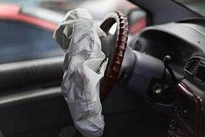 A deployed airbag is seen in a Chrysler vehicle at the LKQ Pick Your Part salvage yard in Medley, Florida, on May 22, 2015.