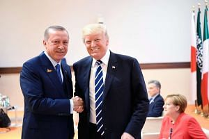 US President Donald Trump (right) shaking hands with Erdogan at the G-20 meeting.