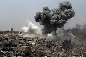 An air strike by US-led coalition forces in Mosul yesterday. The battle to retake the city from ISIS has left large parts of it in ruins, killed thousands of civilians and displaced nearly one million people. The UN predicts it will cost more than $1