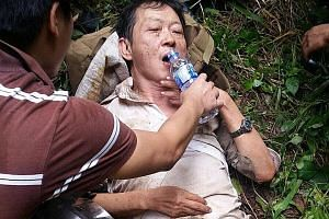 Police searching for Mr Low Ah Kay on Sunday. He was found yesterday in a forested area along Kranji Expressway.