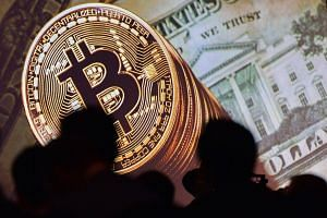 An image of Bitcoin and US currencies is displayed on a screen.