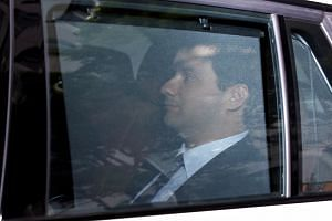 Frenchman Mark Karpeles rides in a car as he arrives at Tokyo District Court for a trial on charges of embezzlement, on July 11, 2017.