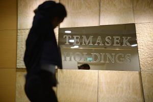 A man walks past the Temasek Holdings office.