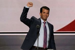 Donald Trump Jr thrusts his fist after speaking at the 2016 Republican National Convention in Cleveland. PHOTO: REUTERS