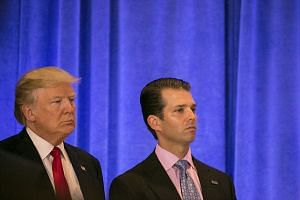 President-elect Donald Trump and his son Donald Trump Jr. at Trump Tower in New York, on Jan 11, 2017.