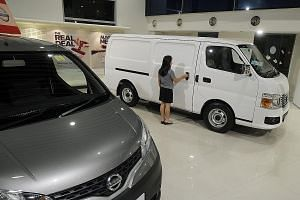Nissan commercial vehicles on display at Tan Chong Motors' showroom. Mr Ron Lim, general manager of the Nissan agent, said the sharp decrease in the commercial vehicle COE supply was a result of far fewer fleet owners scrapping their older vans, truc