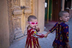 Two children walking down a street in Yarkand, in China's Xinjiang Uighur Autonomus Region.