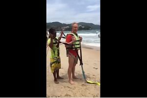 Two Thai men have been charged over the death of Australian Mr Roger Hussey (pictured) after he died during a parasailing accident.
