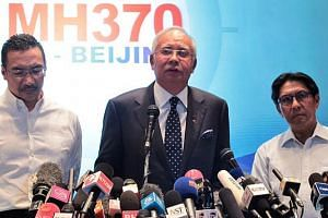 Malaysian Prime Minister Najib Razak (centre), flanked by Defence and Acting Transport Minister Hishammuddin Hussein (left) and Civil Aviation chief Azharuddin Abdul Rahman at the media briefing of the missing Malaysia Airlines Flight MH370 on 15 Mar