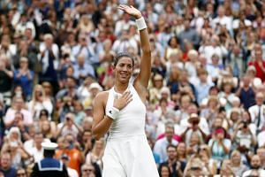 Garbine Muguruza of Spain celebrates her victory over Venus Williams of the US in the women's final of the Wimbledon Championships at the All England Lawn Tennis Club, in London, Britain, on July 15, 2017.