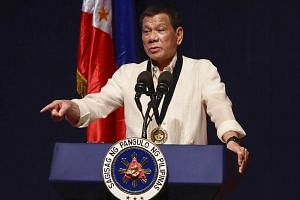 Philippine President Rodrigo Duterte delivers a speech during the 26th anniversary rites of the Bureau of Jail Management and Penology (BJMP) at Camp Aguinaldo in Quezon City on July 12, 2017.