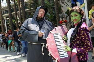 Disney fans pose in their cosplay outfits during the D23 Expo in Anaheim, California, US on July 15, 2017.