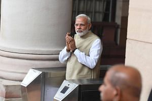 Indian Prime Minister Narendra Modi arrives to cast his vote to elect an Indian President at Parliament House in New Delhi on July 17, 2017.