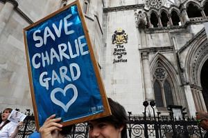 People campaign to show support for allowing Charlie Gard to travel to the United Stated to receive further treatment, outside the High Court in London, Britain, on July 13, 2017.